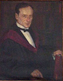 An oil painting of Morris Cohen; Cohen is wearing a white shirt, a black bow tie and what appears to be a black academic gown edged with  maroon trim.