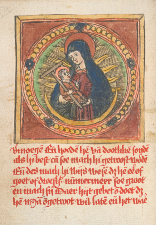 A detail from a medieval prayer-book, with a pasted-in woodcut of the Virgin and Child.