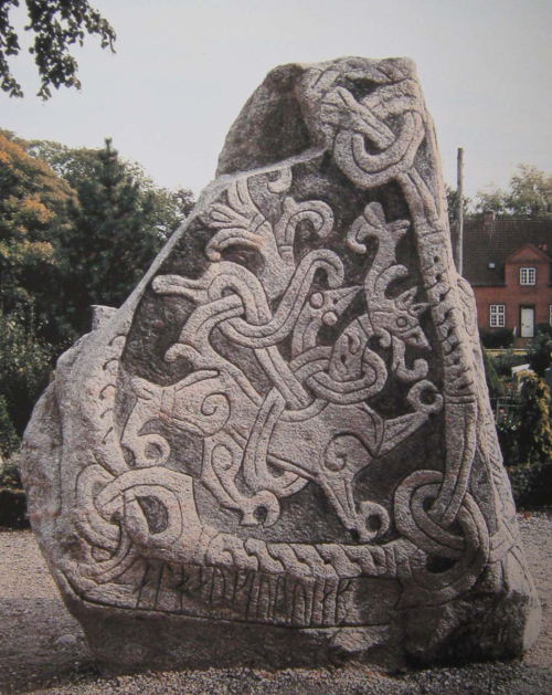The Runestone of Harald Bluetooth, engraved with the figure of an animal, and inscribed with runes.