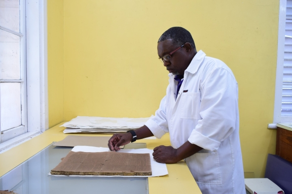 Brian Inniss, Senior Archives Technical Assistant, preparing the Mercury for digitisation