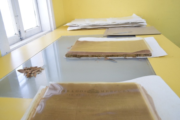 The Barbados Mercury Gazette being disbound at the Conservation Department
