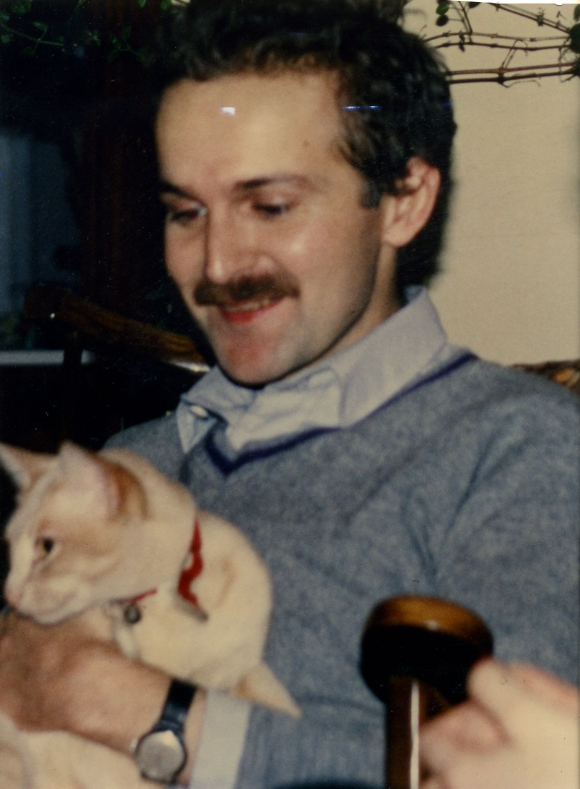 Kevin Stratford in spring 1981, holding a cat