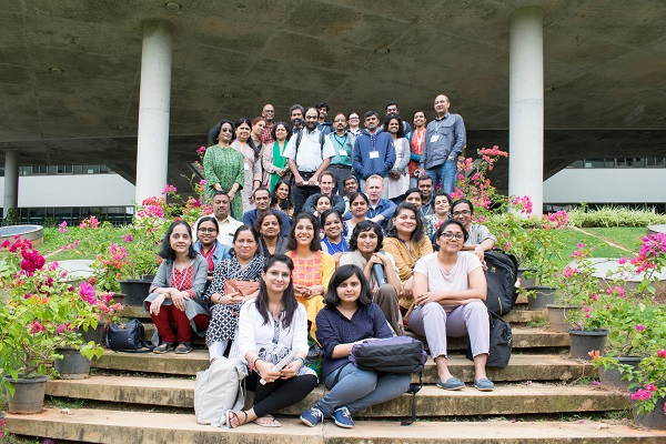 a photo showing the workshop participants sitting outside the main building at NCBS campus