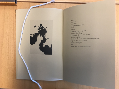 Photograph of Toni Morrison's 'It Comes Unadorned' with silhouette print of a woman, by Kara Walker