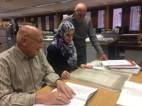 Photograph picturing Sagera Kazmi with John Fritz (left) and George Michell (right) reviewing the original drawings in February 2019.