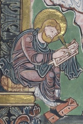 Zachariah writing on a tablet
