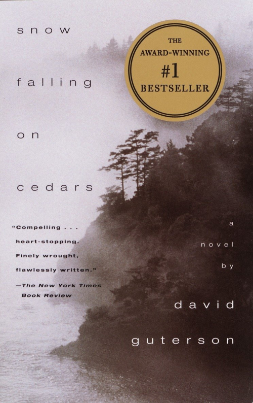 Cover illustration for Snow Falling on Cedars by David Guterson showing black and white photograph of cedar trees by the see