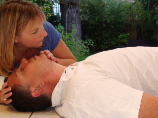 CPR demonstration being conducted, the assessment of 'look, listen and feel' for breathing