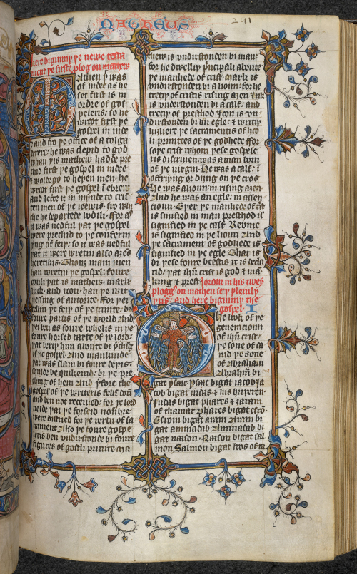A text page with large initials and a border decorated with flowers and vines