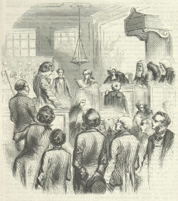 Girl standing in dock in court room