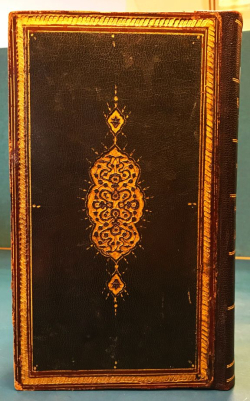 Stamped and gilded binding of the Hamse-i Atā'ī (Or. 13882), alongside f. 1v with one of its magnificent 'unvāns