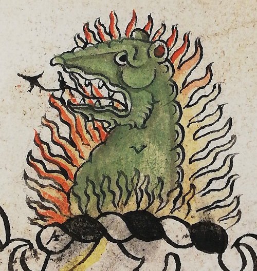 The head of a green salamander surrounded by flames of fire