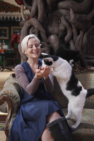Lauren owner of Dinah the Cat Emporium with a cat