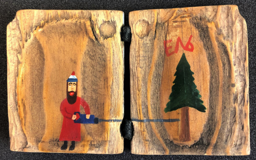 Inside of B. U. Kashkin's wooden artist book, DRrrrr, featuring a painting of him cutting down a fir tree