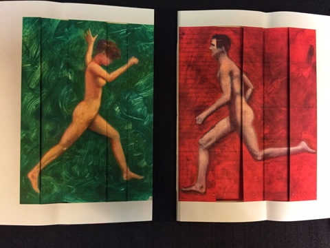 Photo of the book folded open to reveal the two full page illustrations of the figures