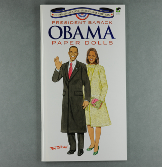 Front cover of the Obama paper dolls booklet featuring cartoons of Barack and Michelle Obama