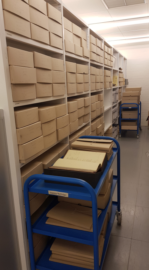 Photograph of Manuscript Storage Area in the British Library, and boxes containing papers from the Archive of Andrew Salkey