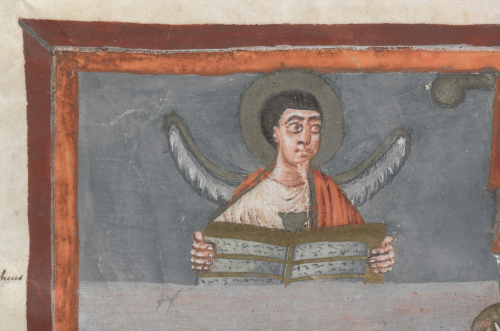 A winged man holding an open book inscribed with symbols