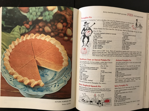 Photograph of inside spread of Betty Crocker book. Full-colour picture shows the pie in all its glory while the right-hand page shows the recipes with small illusrated characters.