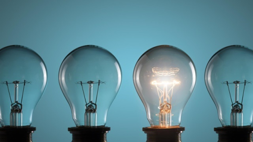 A set of 4 light bulbs presented next to each other, the third light bulb is switched on. The image is supposed to a metaphor to represent an 'idea'