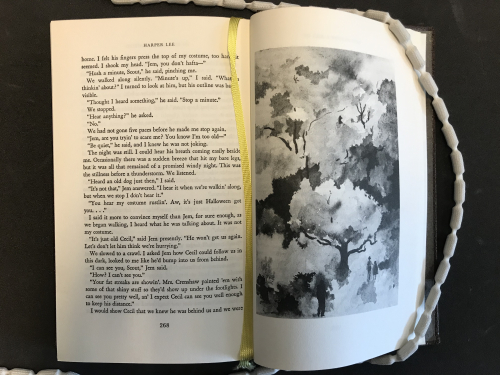 Illustration by Arthur Ranson of Scout and Jem walking under a tree being followed by Cecil from To Kill a Mockingbird