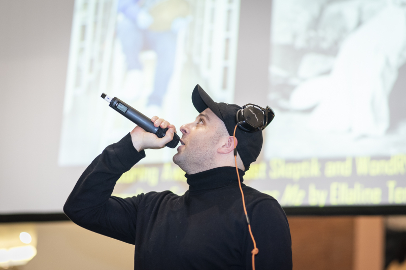 A photograph featuring The Last Skeptik explaining what he did with the sample.