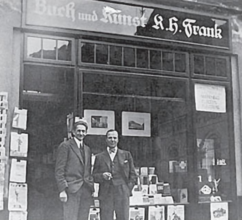 Photograph of Frank in front of his shop
