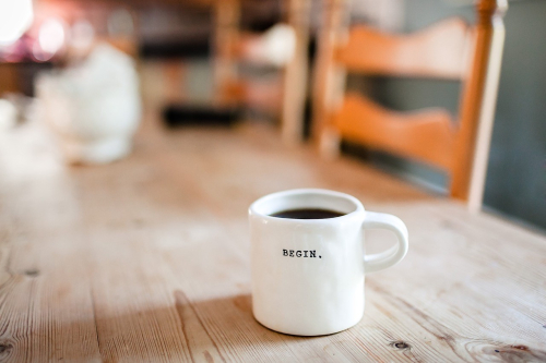 Mug with begin written on it