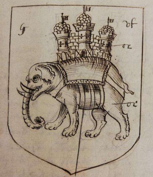 An elephant with a castle with three towers on its back