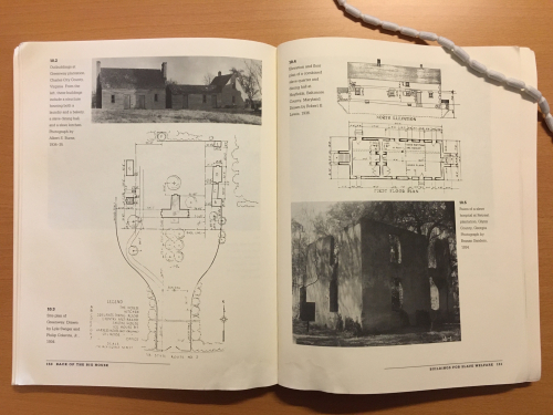 Book open to show photographs and plans of buildings