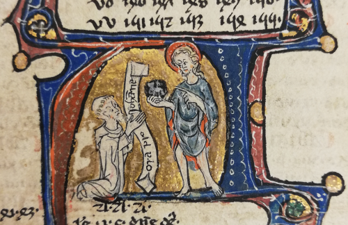 A Gilbertine canon in a white habit, with a tonsure and beard, kneeling in prayer before St John the Baptist, who is holding and pointing to an Agnus Dei