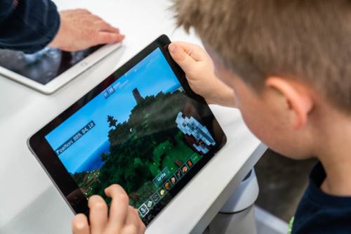Child playing Litcraft on an ipad