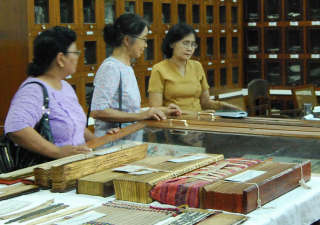 San San viewing MSS at UCL  Rangoon  May 2011-ed