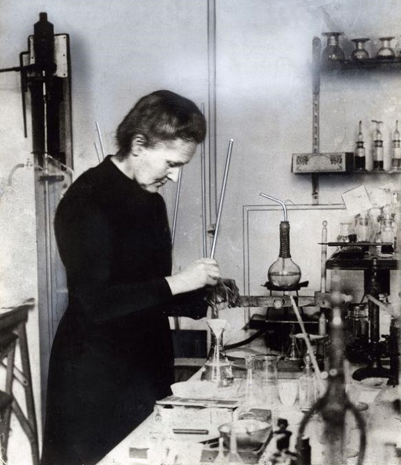 Marie Curie working in her laboratory