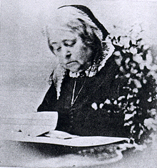 Black and white photo of an elderly Elizabeth Peabody reading
