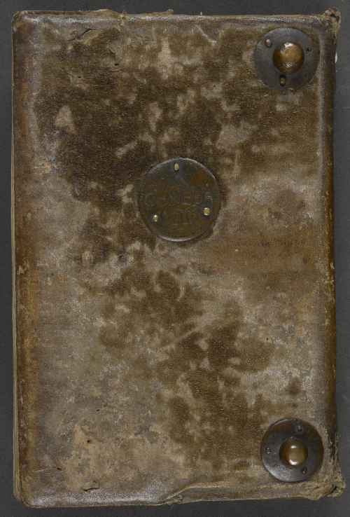 Lower cover of binding in dark brown leather with some patches of darker fur visible at the top and in the middle of the bottom half, with two metal bosses in the upper and lower right corners, as well as a copper roundel inscribed with the title of the text in the middle.