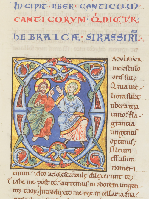 A detail from a medieval Bible manuscript, with an image of Christ and the Virgin Mary inside a decorated letter O