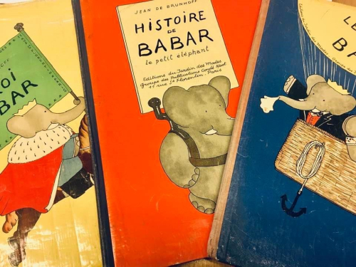 Three covers of Histoires de Babar with illustrations of Babar the elephant