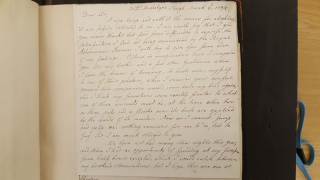 A close-up image of a handwritten manuscript on paper