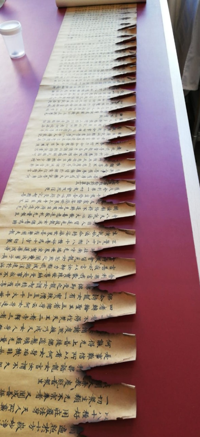 Or 8210 before treatment shown laid out on a desk with visible burn marks and missing areas of text.