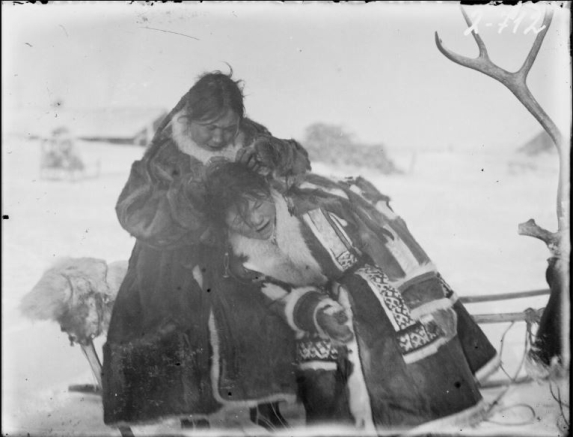 Two girls sitting on a sled
