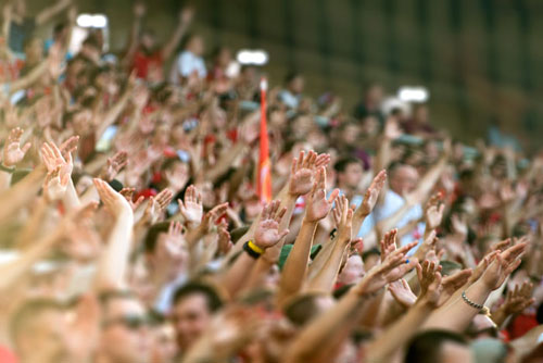 Raised hands in a football crowd.