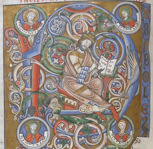 Detail of decorated initial showing Solomon writing 'Parabole Salomonis', with busts of Wisdom, Fortitude, Justice and Prudence, at the beginning of Proverbs