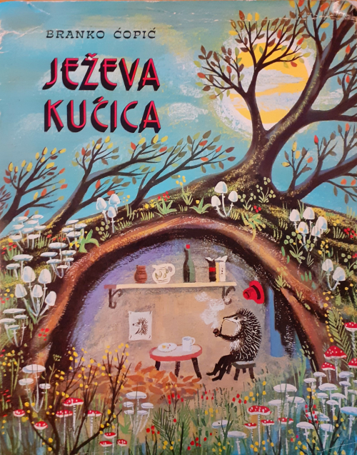 Cover of Ježeva kućica with an illustration of the hedgehog smoking a pipe and having tea in his underground home