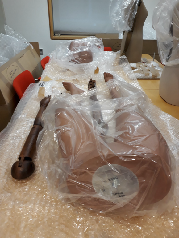 Mannequin pieces on display on a table in the British Library Centre for Conservation