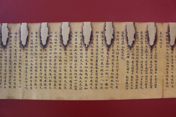 After treatment showing the scroll with Japanese paper repairs.