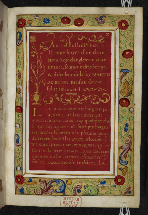 An illuminated page from a 16th-century manuscript, showing a dedicatory letter to Henry VIII, written in gold ink on a red background.