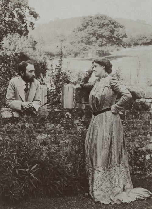 Black and white photographic portrait of Bernard and Mary Berenson at Friday's Hill, Fernhurst, England. Around 1901. The photo shows the couple leaning on a low wall while looking at each other in a contemplative attitude