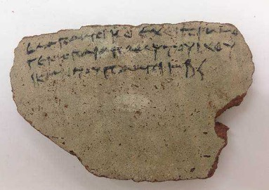 Broken potsherd bearing three lines of Greek text written with ink to testify that Pamyt has paid for fishing tax in 255BC