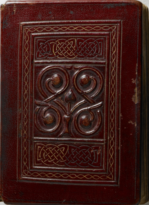 The front cover of the Cuthbert gospel, featuring tooled leather with interlace and plant designs